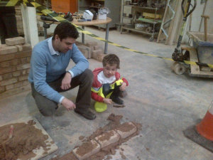 Senior's Sales Director James Keeling-Heane and son William having a go at bricklaying