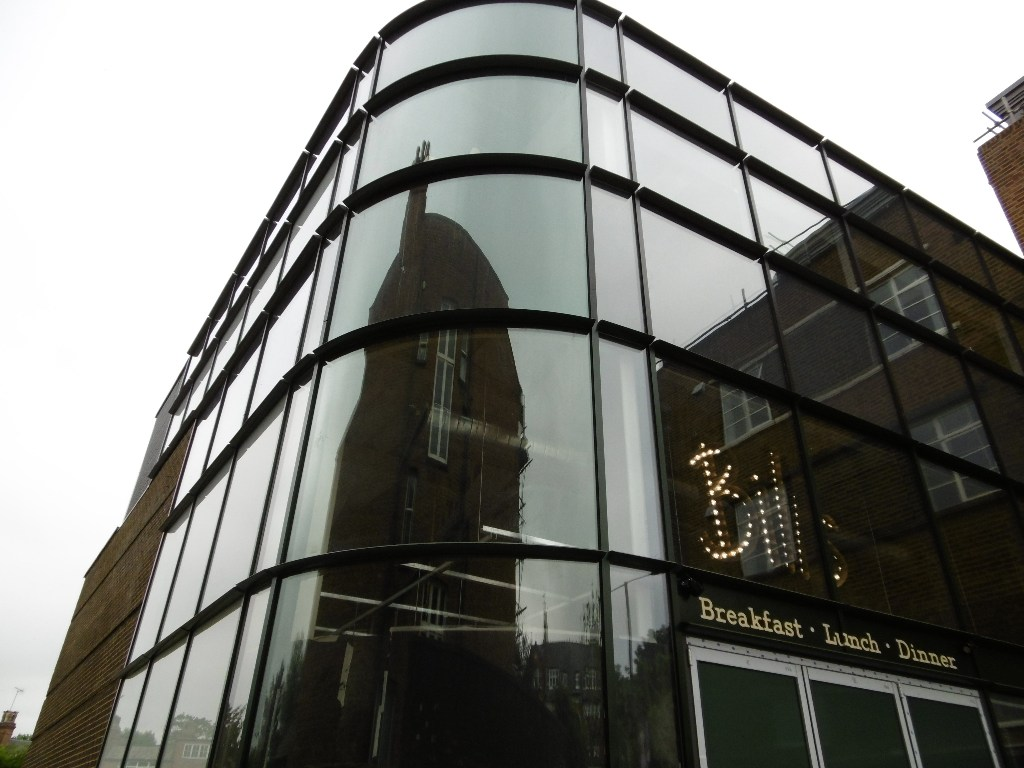 Senior s curved curtain wall transforms listed building for Curved wall